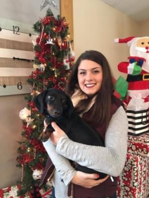 Family member holding dog